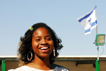 hebrews: DIMONA,ISR - NOV 06:Young Black Hebrews woman on Nov 3 2008.The group is not considered Jews in Israel. The Israeli government refused to grant them citizenship while occasionally pursuing deportation