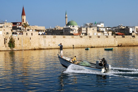 akko: ACRE, ISR - OCT 07:Fishermen fishing at the historic port of Acre on Oct 07 2010.Acre was established as a port city, and became one of the most important cities in the ancient history of Israel.
