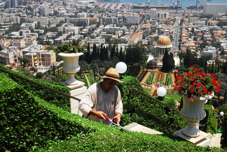baha: HAIFA,ISR - JULY 14:Bahai is gardening the garden of the Bahai Temple on July 14 2008.The Bahai faith was founded in Iran in 1863 by Mirza Husayn ali Nuri 1817-92, known as Bahaullah or Baha Allah.