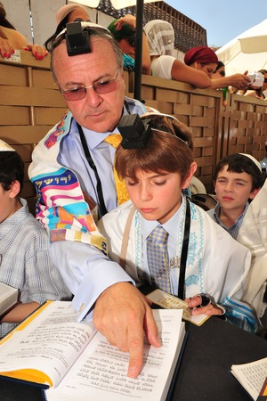 bar mitzvah: JERUSALEM -SEP 22: Bar Mitzvah ritual at the Wailing wall on September 22 2008 in Jerusalem, Israel.Boy who has become a Bar Mitzvah is morally and ethically responsible for his decisions and actions.
