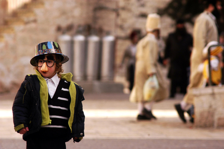 esther: JERUSALEM - MARCH 15: Ultra-orthodox Jewish child celebrates the Jewish holiday Purim on March 15 2006 in Mea Shearim in Jerusalem, Israel.