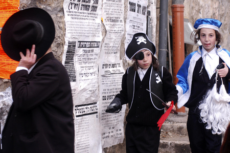 esther: JERUSALEM - MARCH 15: Ultra-orthodox Jewish children celebrates the Jewish holiday Purim on March 15 2006 in Mea Shearim in Jerusalem, Israel. Editorial