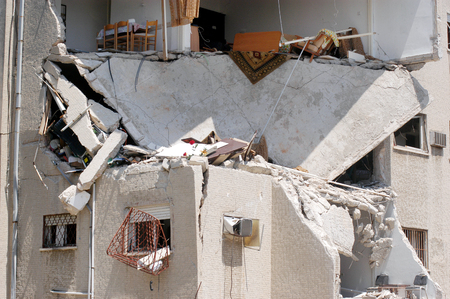 struck: HAIFA, ISR - JULY 21:Bombed-out building that was struck by a Katyusha rocket fired from south Lebanon by Hezbollah on July 21, 2006.In the conflict 165 Israelis where killed and 500,000 displaced. Editorial