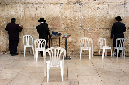 JERUSALEM - OCT 08 :Jewish men pray at the Western Wall during the High Holy Days on Oct 08 2005.During the 10 days before Yom Kippur Holiday Jewish people practice Teshuvah - engaging in repentance.