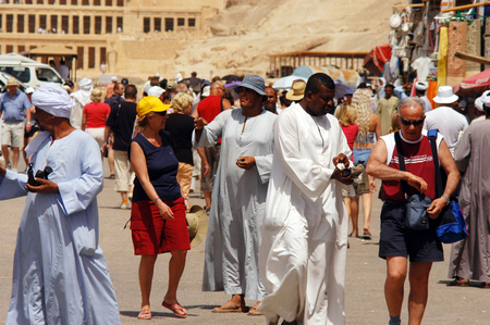 egypt revolution: LUXOR - MAY 02:Egyptians and tourist Interacting at the Great Temple of Hatshepsut on May 02 2007 in Luxor Egypt.The number of tourists visiting Egypt dropped by more than a third since the Egyptian revolution on Jan 25 2011. Editorial