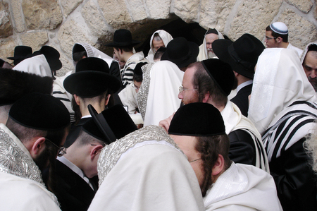 continuously: JERUSALEM - APRIL 07: Orthodox Jewish Pray at the Western Wall during the Jewish holiday of Passover on April 07 2008 in Jerusalem,Israel.Passover is the oldest continuously celebrated Jewish festival Editorial