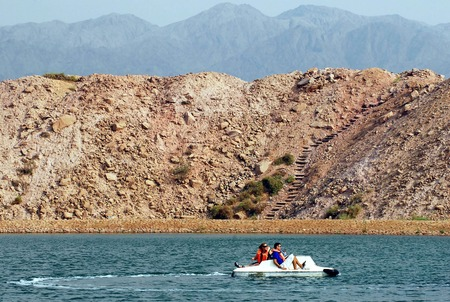 peddle: TIMNA, ISR - OCT 15:Visitors sail a peddle boat over Timna Lake  on October 15 2008.Its the worlds first copper production center founded my the Egyptian in the in Timna valley over 5000 years ago.