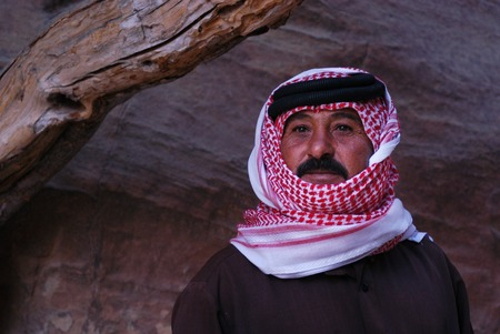 keffiyeh: PETRA - NOV 09:A Jordanian man wearing red Keffiyeh in Petra, Jordan on November 09 2007.It has been used by arabs throughout the centuries and was used as a symbol of honor and tribal identification. Editorial