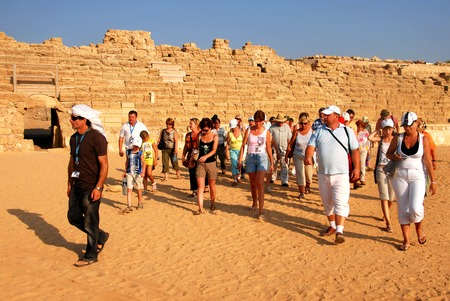 CAESAREA - AUG 23:Visitors at Ceasarea on Aug 23 2007. The ancient Caesarea Maritima city and harbor was built by Herod the Great about 2513 BCE. Editorial