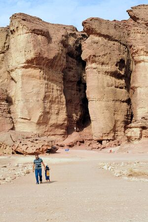 timna: TIMNA, ISR - OCT 15:Visitors under Solomons pillars in Timna Park on October 15 2008.Its the worlds first copper production center founded my the Egyptian in the in Timna valley over 5000 years ago.