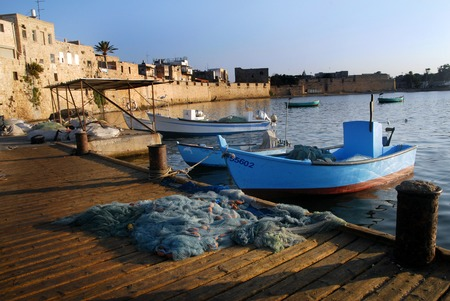 bce: ACRE, ISR - OCT 07:Fishing boats in Acre port on OCT 07 2007. Its one of the oldest continuously inhabited cities in the world, dating back to the time of the Pharaoh Thutmose III 1504-1450 BCE.