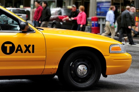 hectic life: NEW YORK CITY - OCT 11:Yellow Taxicab in Manhattan on October 11 2009.There are about 14,000 yellow cabs on the road in New York City.