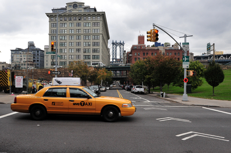 hectic life: Yellow taxi cab near Manhattan bridge, one of the public transportation in Manhattan New York, USA.