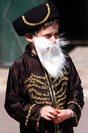 book of esther: JERUSALEM - MARCH 05: Israeli child dressed up with Mordecai the Jew costume during the Jewish holiday Purim on March 05 2007 in Mea Shearim in Jerusalem, Israel. Editorial