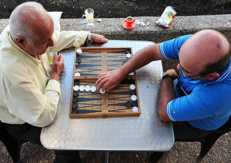 TEL AVIV - NOV 17: An old arab men playing backgammon on November 17 2008 in Tel Aviv, Israel.Its one of the oldest board games for two players in the world.