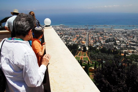 baha: HAIFA,ISR - JULY 14:Visitors at the Bahai Temple and gardens on July 14 2008.The Bahai faith was founded in Iran in 1863 by Mirza Husayn ali Nuri 1817-92, known as Bahaullah or Baha Allah. Editorial