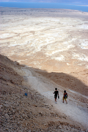 holyland: MASADA,ISR - OCT 21:Visitors climbing down Masada Fortress in Israel by using the steep ancient snake path on Oct 21 2006.Masada considered as one of the most popular tourist destination in Israel.