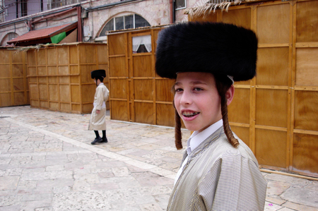 tabernacles: JERUSALEM - OCT 20:Young ultra orthodox Jewish men during Sukkot Jewish holiday in Mea Shearim on October 20 2005 Jerusalem, Israel.