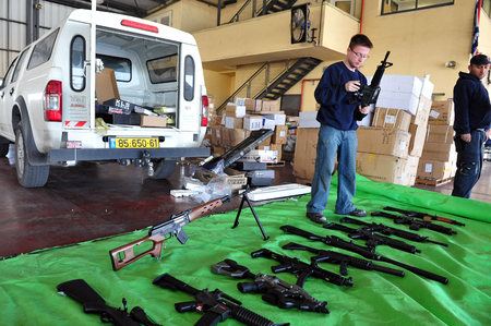 organized crime: ASHDOD, ISR - JAN 15:Shipment of imitation guns to Gaza strip exposed by the Israeli customs on Jan 15, 2008.The toy guns intended for use in military training and to confuse the IDF forces during war