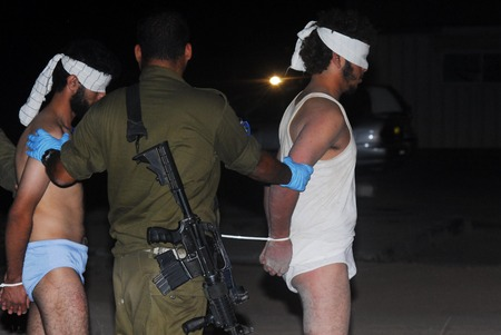 political prisoner: NACHAL OZ, ISR - AUG 02: Injured Fatah men are fleeing into Israel with the help of Israels Defense Force and emergency services after bloody clashes in the Gaza Strip on August 2, 2008 in Nachal Oz, Israel.