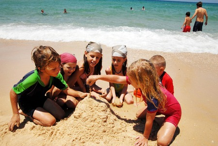 constituting: ASHDOD - JULY 20:Israeli children build sand castles on July 20 2007.The population of children living in Israel numbered ABOUT of 2,500,000 children, constituting over 30 of the general population. Editorial