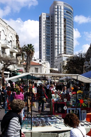 israelis: TEL AVIV -JAN 27:Israelis shopping at Nachalat Binyamin pedestrian mall on Jan 27 2007.Its a colorful open-air bazaar of unique handicrafts, street performances, pantomime and musicians.