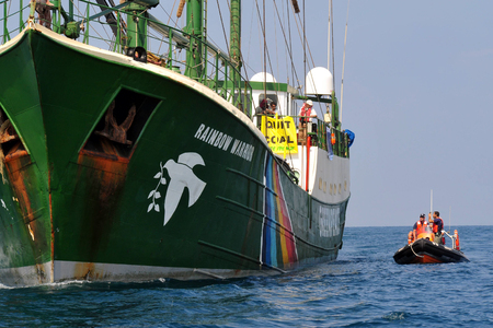 greenpeace: ASHKELON, ISR - SEP 03:Israeli water police officer patrol and the Rainbow Warrior on Sep 08 2008, during protest against Israels plan to build a new electric power plant fueled by coal.