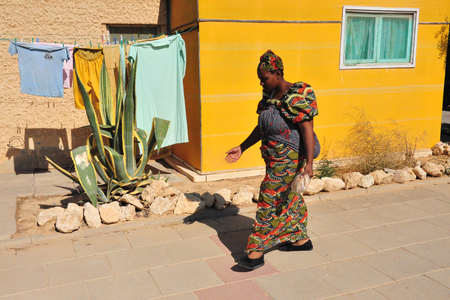 african ancestry: DIMONA, ISR - NOV 06:Black Hebrews woman on Nov 3 2008.Their clothing is based on Biblical guidelines, consisting of natural fibers with fringes and blue cord. Editorial