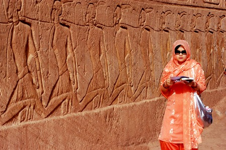 RELOCATED: ABU SIMBLE - APRIL 29:Muslim woman visit at the Great Temple of Abu Simbel on the border of Egypt and Sudan on April 29 2007.The temples were dismantled and relocated in 1968 when Aswan dam was built.