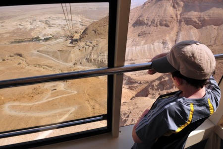 holyland: MASADA,ISR - SEP 17:The cable car to Masada stronghold on September 17 2008 in Judea Desert, Israel.Masada considered as most popular tourist destination in Israel, outside of Jerusalem. Editorial
