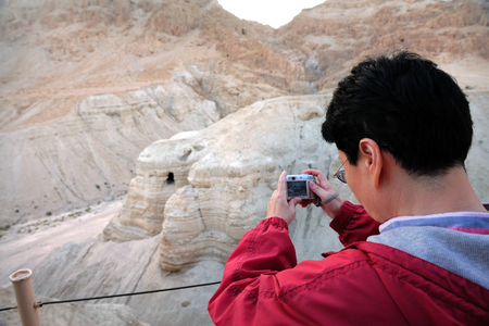 judaean desert: QUMRAN, ISR - DEC 14:Visitor take pictures of Qumran Caves on December 14 2008.The Dead Sea Scrolls were discovered in eleven caves in Qumran near the Dead Sea between the years 1947 and 1956.