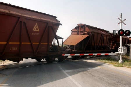 boxcar train: ASHKELON, ISR - MAY 25:Cargo train transporting Phosphate on May 25 2010.The inorganic chemical found in Israel is used in different Israeli industries such as food and medicine and agriculture. Editorial