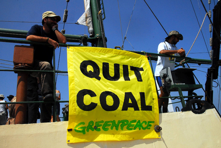 greenpeace: ASHKELON, ISR - SEP 03: Greenpeace activists on the Rainbow Warrior protesting on Sep 08, 2008. against Israels plan to build a new electricity power plant  fueled by coal in Ashkelon, Israel.