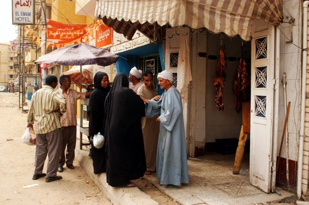 past production: ASWAN - APRIL 28: An Egyptian man selling fresh meat in Aswan market, Egypt on April 28 2007.Egypts total agricultural crop production has increased by more than 20 percent in the past decade.