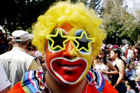 jewish community: ASHKELON - MARCH 14: Israeli man dressed up with a clown costume celebrate the Jewish holiday Purim on March 14 2006 in the Ashkelon,Israel.