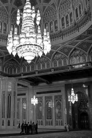 muscat: MUSCAT, OMAN - DEC 25 2007:Visitors inside Sultan Qaboos Grand Mosque in Muscat Oman in Muscat, Oman.It is the only mosque in Oman that allows tourists inside the complex Editorial