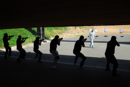 NACHAL OZ, ISR - MAR 26:Security personal are practicing shooting in a shooting Range on March 26 2008.Its forbidden in Israel to own any kind of firearm, including air pistols and rifles, without a firearms license.