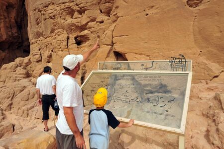 timna: TIMNA, ISR - OCT 15:Visitors looks at murals in Timna Park on October 15 2008.Its the worlds first copper production center founded my the Egyptian in the in Timna valley over 5000 years ago. Editorial