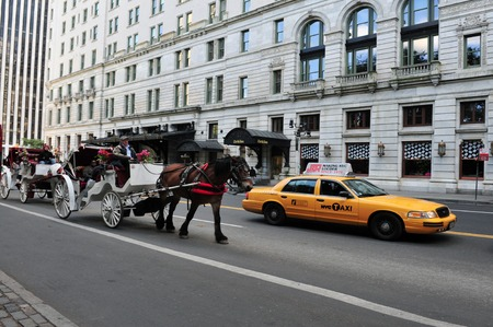 hectic life: Yellow taxi cab, one of the public transportation in Manhattan New York, USA. Editorial