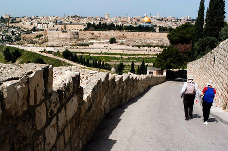 mount of olives: JERUSALEM - APR 13:Visitors walks down to Jerusalem old city from Mount Olives on Apr 13 2006.Its 5000 years old and Its one of the oldest and most important cities in the whole world.