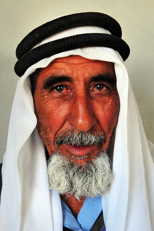 bedouin: WESTERN NEGEV - NOVEMBER 26:A portrait of a Bedouin man from Lakyia Bedouin village in southern Israel wearing a traditional kufeya  on November 26 2008.egev Bedouin are formerly nomadic and later also semi-nomadic Arabs who live by rearing livestock in t