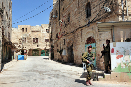 jewish community: HEBRON, ISRAEL - SEP 08:Israeli soldiers gourds on the Jewish quarter of Hebron on September 09 2009.Hebron is the site of the oldest Jewish community in the world, which dates back to Biblical times.
