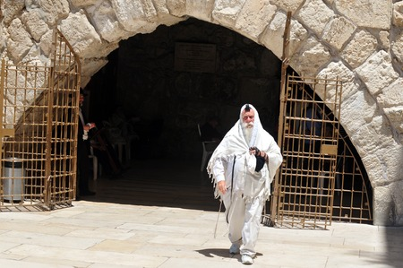 judaic: JERUSALEM - JULY 20:Jewish man pray in The Cave Synagogue at the Western wall on July 20 2009 in Jerusalem, Israel. Traditionally, it is regarded as the only remnant of the Jewish Temple. Editorial