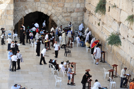 hassid: JERUSALEM - APRIL 19:Visitors at the Wailing Wall on April 19 2010 in Jerusalem, Israel.Its arguably the most sacred site recognized by the Jewish faith outside of the Temple Mount itself.