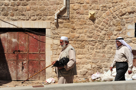 religious clothing: HEBRON, ISRAEL - SEP 08:Arab men walks in Hebron on September 09 2009.There are 163,000 Palestinians living in Hebron Editorial