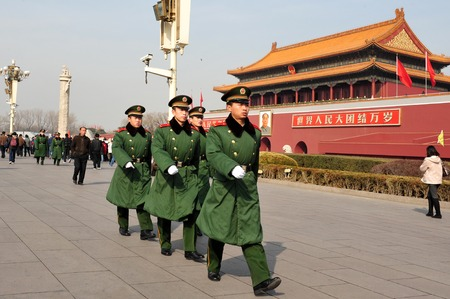 chinese people: BEIJING - MARCH 11:Chinese soldiers march in Tiananmen square on March 11 2009 in Beijing,China.Its the third largest square in the world and important site in Chinese history