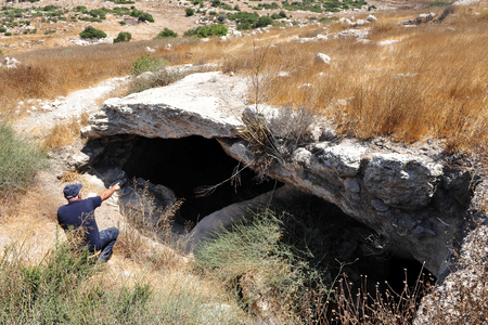 judaean: AMATZIA, ISR - AUG 02:Visitors at Amatzia Caves near Kiryat Gat on August 02 2009.During troubled times, the Jews of ancient Israel often dwelled in artificial limestone underground caves.