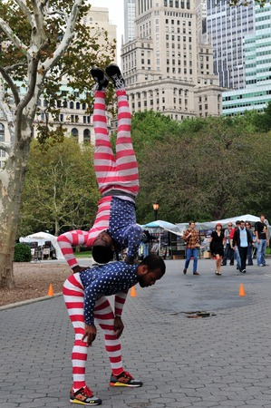 greatly: NY - OCT 09: Black Americans street acrobats during a  show in Battery Park on October 09 2009 in Manhattan New York.Acrobats were greatly admired in ancient China, Egypt, and the Minoan civilization. Editorial