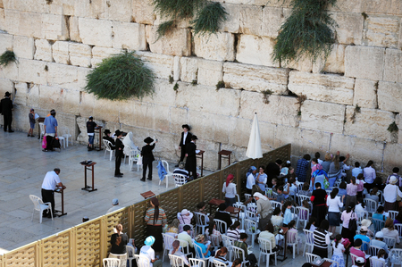 tora: JERUSALEM - APRIL 19:Visitors at the Wailing Wall on April 19 2010 in Jerusalem, Israel.Its arguably the most sacred site recognized by the Jewish faith outside of the Temple Mount itself.
