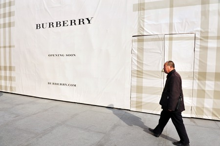 importer: BEIJING - MARCH 11:Chines man walks besid a new Burberry shop on Mar 11 2009 in Beijing China.China is the second largest importer of goods in the world. Editorial